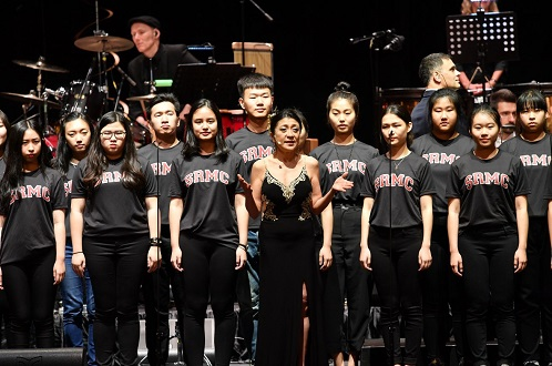Pamela Tan-Nicholson with the youth choir from Singapore Raffles Music College