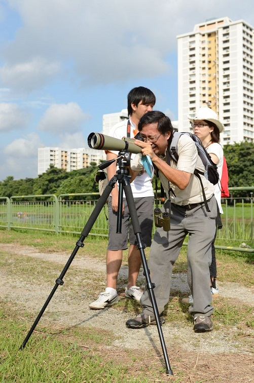Photographer with Large Lens